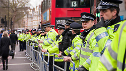 © Licensed to London News Pictures. 02/04/2015. Baker Street, London, UK. Police lined up outside the London Central Mosque during the Islamic Rally.  Photo credit : Stephen Chung/LNP
