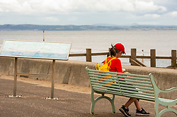 Meditation time<br /> <br /> The weather was neither hot nor cold as Portobello residents took to the beach with plenty of social distancing possible. Kids, dogs and frogmen in the water all part of the easing of the lockdown scene.