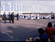 Pope John-Paul II visits Ireland..1979..29.09.1979..09.29.1979..29th September 1979..Today marked the historic arrival of Pope John-Paul II to Ireland. He is here on a three day visit to the country with a packed itinerary. He will celebrate mass today at a specially built altar in the Phoenix Park in Dublin. From Dublin he will travel to Drogheda by cavalcade. On the 30th he will host a youth rally in Galway and on the 1st Oct he will host a mass in Limerick prior to his departure from Shannon Airport to the U.S..Image of the clergy as the move out to distribute communion to the massive congregation.