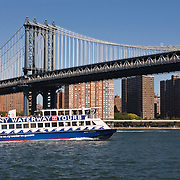 NY Waterway Tours passing under the Manhattan Bridge in Lower Manhattan