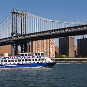 NY Waterway Tours passing under the Manhattan Bridge in Lower Manhattan