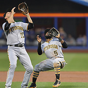 NEW YORK, NEW YORK - June 16: Jordy Mercer #10 of the Pittsburgh Pirates and Josh Harrison #5 of the Pittsburgh Pirates fielding an infield fly ball during the Pittsburgh Pirates Vs New York Mets regular season MLB game at Citi Field on June 16, 2016 in New York City. (Photo by Tim Clayton/Corbis via Getty Images)