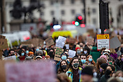 Demonstrators hold up placards as they gather outside Parliament Square in central London on Sunday, March 14, 2021, during a protest over the abduction and murder of Sarah Everard and the subsequent handling by the police of a vigil honouring the victim. London's Metropolitan Police force was under heavy pressure Sunday to explain its actions during a vigil for Sarah Everard whom one of the force's own officers is accused of murdering. (VXP Photo/ Vudi Xhymshiti)