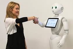 © Licensed to London News Pictures. 13/04/2016.  Chole Butler interacts with Pepper the robot at the 'World of Me' by Accenture, at the world's first Millennial 20/20 Business Summit. The two day event is the grand gathering of over 3000 startups, brands and retailers. London, UK. Photo credit: Ray Tang/LNP