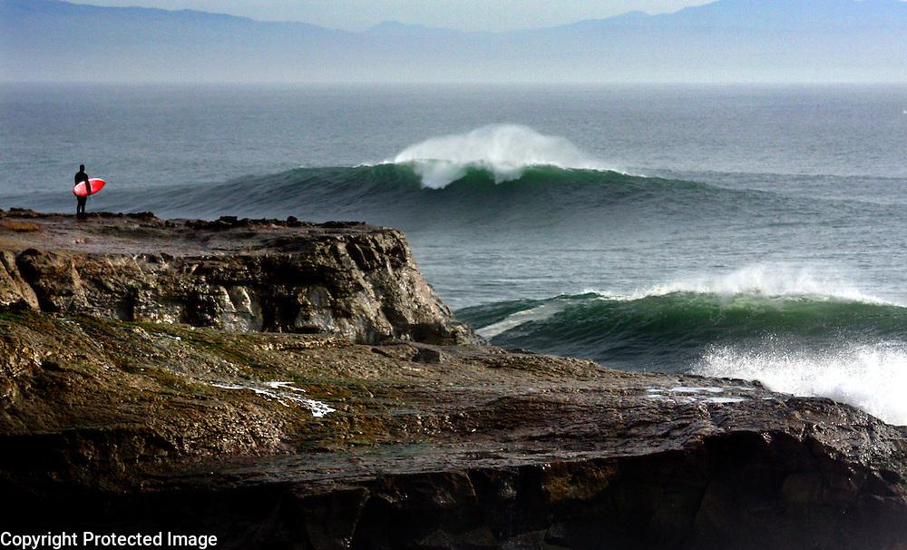 A big swell pours past Lighthouse Point into Steamer Lane and Its Beach in Santa Cruz, California.<br /> Photo by Shmuel Thaler <br /> shmuel_thaler@yahoo.com www.shmuelthaler.com