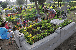 November 2, 2018 - Kolkata, India - An Indian Christian offers prayers on a grave during All Souls Day celebration in a cemetery in Kolkata on November 2, 2018. All Soul's Day, also known as The Day of the Dead, is a Roman Catholic day of remembrance for friends and loved ones who have passed away. (Credit Image: © Debajyoti Chakraborty/NurPhoto via ZUMA Press)