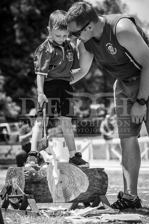 5-year-old Aleksander Meyer helped by his dad Jacob at the Wood Chopping Carnival, Rotorua, New Zealand.<br /> Shot on assignment for New Zealand Geographic Issue 159 September - October 2019.<br /> Read the Feature: https://www.nzgeo.com/stories/block-busters/