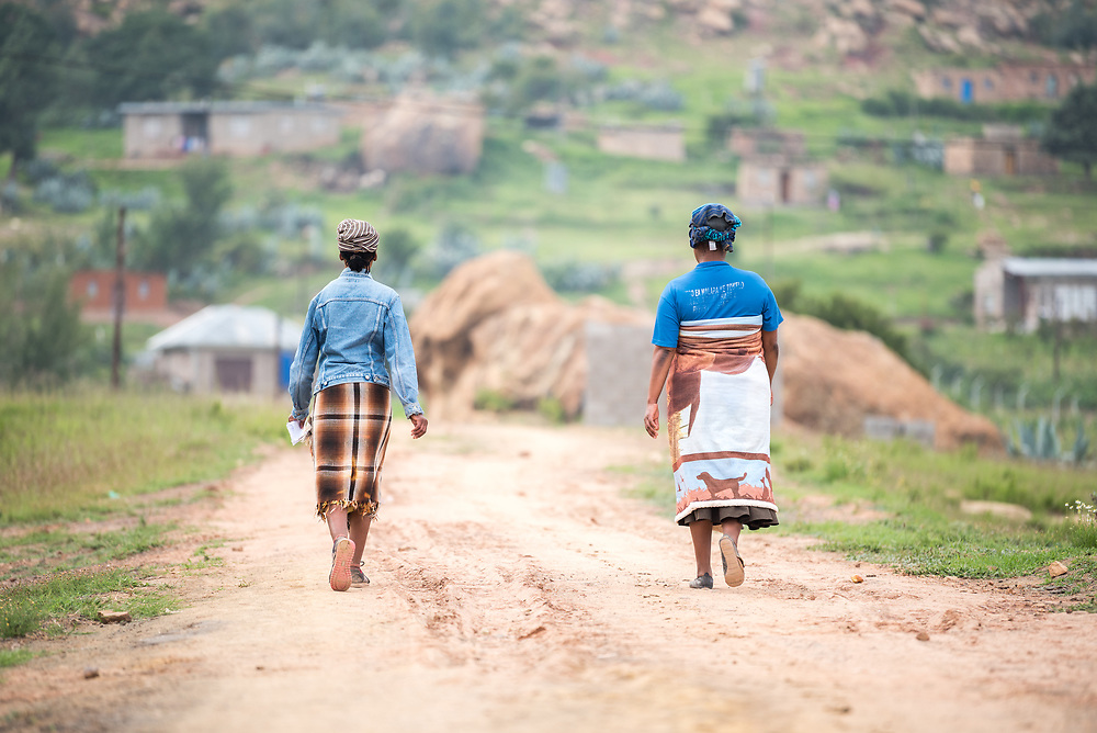 28 February 2017, Thaba Bosiu, Lesotho: Women walking through the village of Thaba Bosiu, Lesotho.  Thaba Bosiu is a sandstone plateau some 24 kilometers east of Lesotho's capital, Maseru. The name means Night Mountain, and surrounding the plateau is a small village and open plains. Thaba Bosiu was once the capital of Lesotho, and the mountain was the stronghold of the Basotho king when the kingdom of Lesotho was formed.