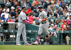 May 13, 2018 - Denver, CO, U.S. - DENVER, CO - MAY 13: Milwaukee Brewers infielder Travis Shaw (21) is congratulated by Third Base Coach Ed Sedar (0) following a homerun during a regular season MLB game between the Colorado Rockies and the visiting Milwaukee Brewers on May 13, 2018 at Coors Field in Denver, CO. (Photo by Russell Lansford/Icon Sportswire) (Credit Image: © Russell Lansford/Icon SMI via ZUMA Press)