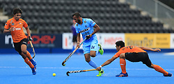 India's Sunil Sowmarpet (left) and Malaysia's Najmi Jazlan battle for the ball during the Men's World Hockey League match at Lee Valley Hockey Centre, London.