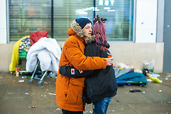 © Licensed to London News Pictures. 25/12/2020. Manchester, UK. Homeless couple NATHAN DALE (25) and AMY DEWHURST (26) share a hug , on Market Street in Manchester City Centre on Christmas Day . Photo credit: Joel Goodman/LNP