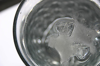 Glass filled with water and ice