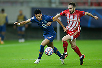 PIRAEUS, GREECE - DECEMBER 09: Luis Díaz of FC Porto and Kostas Fortounis of Olympiacos FC during the UEFA Champions League Group C stage match between Olympiacos FC and FC Porto at Karaiskakis Stadium on December 9, 2020 in Piraeus, Greece. (Photo by MB Media)