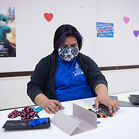 Boys and Girls Club staff member Johnnie Yazzie researches arts and crafts projects to make a YouTube video for the Boys and Girls Club YouTube channel Wednesday in Gallup at Rio West Mall. Boys and Girls Club staff members produce arts and crafts, healthy meals and reading videos weekly.