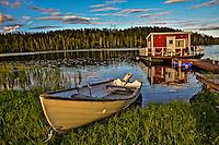 Floating cottage (stuga) and rowboat in Northern Sweden.
