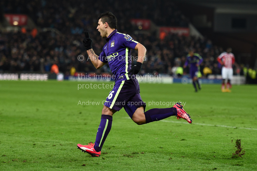 Sergio Aguero of Manchester city celebrates after he scores his teams 1st goal.  Barclays Premier League match, Stoke city v Manchester city at the Britannia Stadium in Stoke on Trent , Staffs on Wed 11th Feb 2015.<br /> pic by Andrew Orchard, Andrew Orchard sports photography.