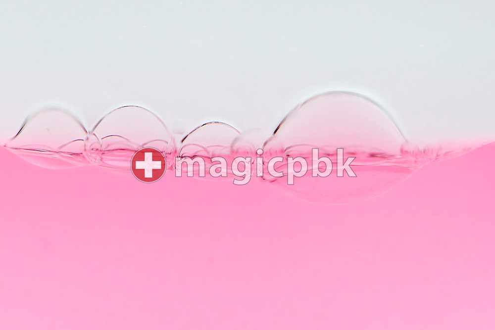 Bubbles seen in an Aura-Soma Equilibrium no. 11 (B11, Clear / Pink) during a studio product photo session held at Aura-Soma Germany in Heiligenhaus, Germany, Saturday, Sept. 13, 2014. (Photo by Patrick B. Kraemer / MAGICPBK)