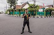 INDONESIA, Central Java, Yojakarta, traffic officer on the street