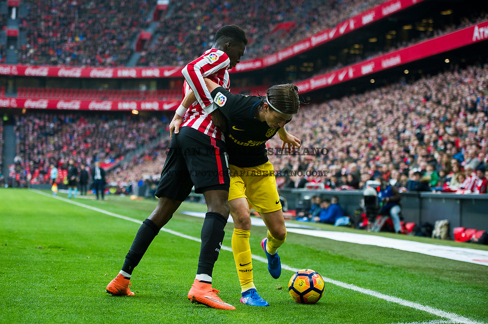 BILBAO, SPAIN - JANUARY 22:  Filipe Luis of Atletico Madrid competes for the ball with Inaki Willams of Athletic Club during the La Liga match between Athletic Club Bilbao and Atletico Madrid at San Mames Stadium on January 22, 2017 in Bilbao, Spain.  (Photo by Juan Manuel Serrano Arce/Getty Images)