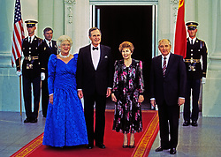 United States President George H.W. Bush, left center, and President Mikhail Gorbachev of the Union of Soviet Socialist Republics, right, pose for a group photo with their wives in front of the North Portico of the White House in Washington, DC prior to a state dinner on Thursday, May 31, 1990. From left to right: First lady Barbara Bush, President Bush, Raisa Gorbachev, and President Gorbachev. Photo by Dennis Brack / Pool via CNP /ABACAPRESS.COM