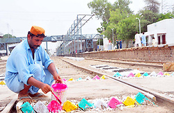 July 13, 2017 - Pakistan - LARKANA, PAKISTAN, JUL 13: Railway workers are busy in decorating their railway track .lines and path, at Railway Station in Larkana on Thursday, July 13, 2017. (Credit Image: © PPI via ZUMA Wire)