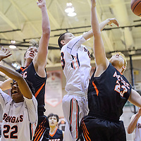 Gallup Bengal Ty Begay (23) swats a rebound away from the Aztec Tigers Tuesday at Gallup High School.