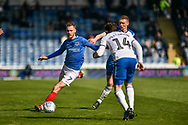 Portsmouth Midfielder, Tom Naylor (7) takes on Rochdale Midfielder, Oliver Rathbone (14) during the EFL Sky Bet League 1 match between Portsmouth and Rochdale at Fratton Park, Portsmouth, England on 13 April 2019.