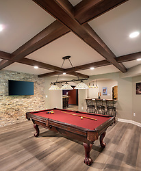 7075 Balmoral home Basement build-out with bar, pool table, Home theatre, and fireplace