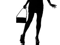 stylish sexy silhouette caucasian beautiful woman legs walking close up details walking on studio isolated white background
