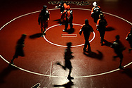 The Hickory Hornet wrestling team runs onto the mat for warm-ups before their final home match of 2008 against the state ranked Reynolds Raiders. The Raiders won the match-up of unbeatens, 61-9.