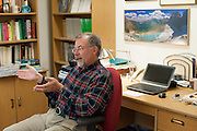 Daniel Fagre Ph.D., a research ecologist for the USGS in his office in the Global Change building in Glacier National Park, West Glacier, Montana, Tuesday, October 7, 2014. He described the effects of receding glaciers to mountain ecosystems. Fagre and his staff are working on the climate change in mountain ecosystems project which includes looking at what has happened in Glacier National Park since the little ice age ended in 1850.