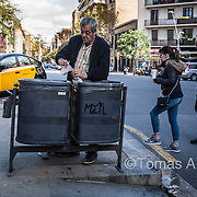 As much as 4% of the city's population suffer from nutritional deprivation, and 15% cannot afford to keep their homes at an adequate temperature. A resident of the Sagrada Família neighbourhood retrieves remnants of milk coffee from the multinational Starbuck's that tourists throw in the garbage.