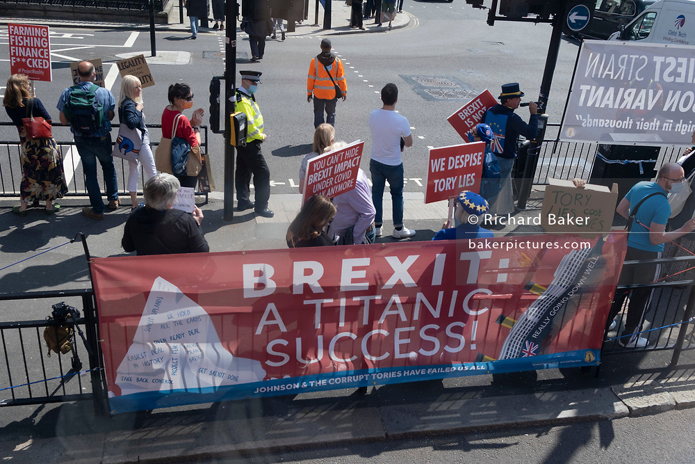 On the fifth anniversary of the historic Brexit vote, Brexit protesters stand in Whitehall before Prime Minister Boris Johnson passes-by towards Parliamant, for Prime Minister's Questions in the House of Commons, on 23rd June 2021, in Westminster, London, England.