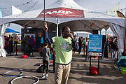 Host Wali Collins talk to the crowd at the AARP Block Party at the Albuquerque International Balloon Fiesta in Albuquerque New Mexico USA on Oct. 7th, 2018.