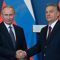 Vladimir Putin (L) president of Russia and Viktor Orban (R) prime minister of Hungary shake hands during a press conference in Budapest, Hungary on February 02, 2017. ATTILA VOLGYI