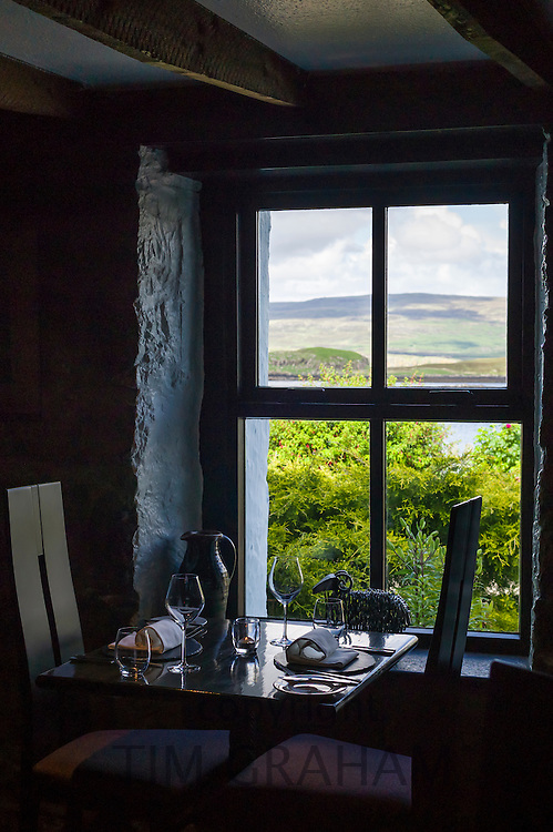 Table place setting with glassware, crockery and napkins at the world renowned gastronomic five star restaurant The Three Chimneys on the Isle of Skye in Scotland