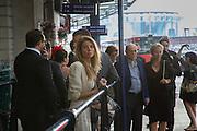 Taxi queue returning from ascot. Royal Ascot racegoers at Waterloo station. London. 18 June 2013.
