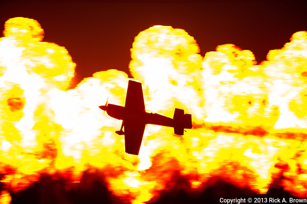 """Super Dave Mathieson flying past """"The Wall of Fire"""" at the Airshow of the Cascades."""