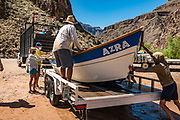 Take out our rafts at Diamond Creek at Colorado River Mile 225.9 on the Hualapai Indian Reservation. Day 16 of 16 days rafting 226 miles down the Colorado River through Grand Canyon National Park, Arizona, USA. During this pandemic trip (April 3-18, 2021), masks were required during the initial meeting in Flagstaff, for bus rides, for initial embarkation at Lees Ferry, for serving lines at all meals, and for final disembarkation at Diamond Creek. Otherwise, our healthy outdoor raft trip was unencumbered by facial coverings. For this photo's licensing options, please inquire at PhotoSeek.com. .