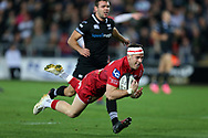 Gareth Davies of the Scarlets © dives over to score his teams 2nd try and his 2nd  try in 2nd half.  Guinness Pro14 rugby match, Ospreys v Scarlets at the Liberty Stadium in Swansea, South Wales on Saturday October 7th 2017. <br /> pic by Andrew Orchard, Andrew Orchard sports photography.