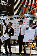 Kevin Federline, (left)  husband of the famous singer Britney Spears, moments before signing a petition in collaboration with Virgin, during a Virgin Mobile promotion event at Time Square, New York, on Wednesday, June 21, 2006. The petition against the abolition of the Penny coin, sponsored by Virgin Mobile, will be then sent over to lawyers in Washington. After this extraordinary event, Virgin Mobile will allow customers to buy 1000 text messages a month for only $9.99, just one humble penny per text.  **ITALY OUT**