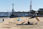 urban picnic camping with shipyard in the background Yokosuka Japan