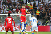 England Defender Gary Cahill heads clear during the Euro 2016 Group B match between Slovakia and England at Stade Geoffroy Guichard, Saint-Etienne, France on 20 June 2016. Photo by Phil Duncan.