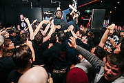 crowdsurfing with crutches at a Red Fang show.