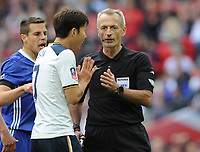 Football - 2016 / 2017 Emirates FA Cup - Semi-Final: Chelsea vs. Tottenham Hotspur<br /> <br /> Heung - Min Son of Tottenham who gave away the penalty kick, pleads with Referee, Martin Atkinson at Wembley.<br /> <br /> COLORSPORT/ANDREW COWIE