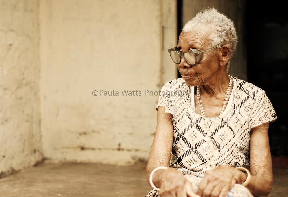 Old Zambian woman with stylish accessories
