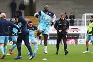 Wycombe Wanderers Adebayo Akinfenwa(20) warms up during the EFL Sky Bet League 1 match between Burton Albion and Wycombe Wanderers at the Pirelli Stadium, Burton upon Trent, England on 26 December 2018.
