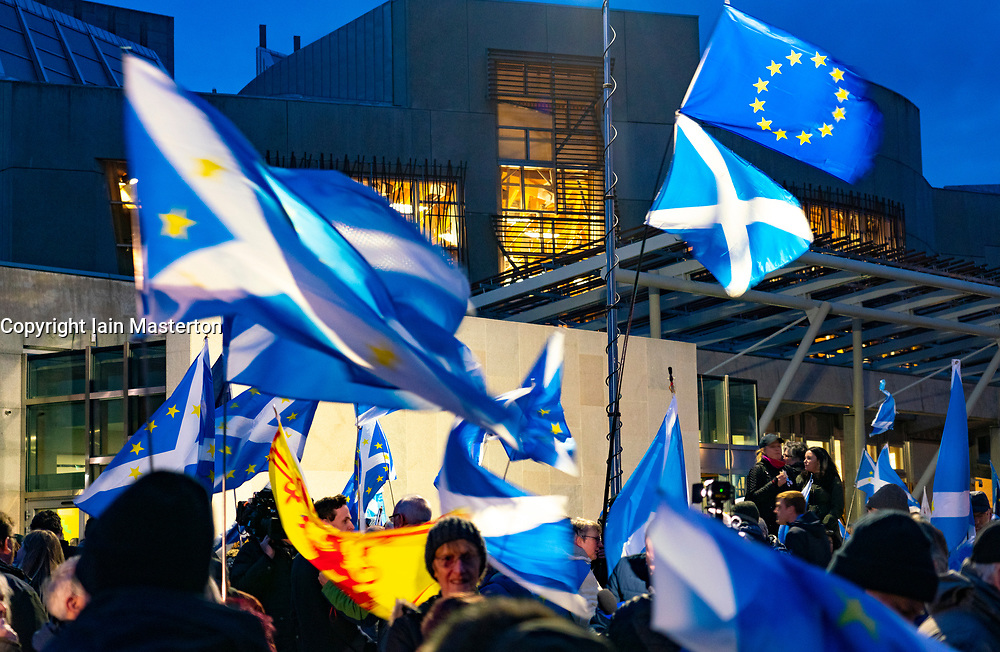"""Edinburgh, Scotland, UK. 31 January, 2020. On Brexit night hundreds of anti Brexit and pro Scottish Independence protesters gathered at the Scottish Parliament at Holyrood for """"Missing EU Already"""" demo and to listen to speeches and demonstrate support for the European Union. Iain Masterton/Alamy Live News."""