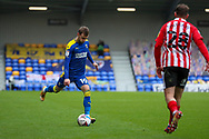 AFC Wimbledon attacker Shane McLoughlin (19) passing the ball during the EFL Sky Bet League 1 match between AFC Wimbledon and Sunderland at Plough Lane, London, United Kingdom on 16 January 2021.