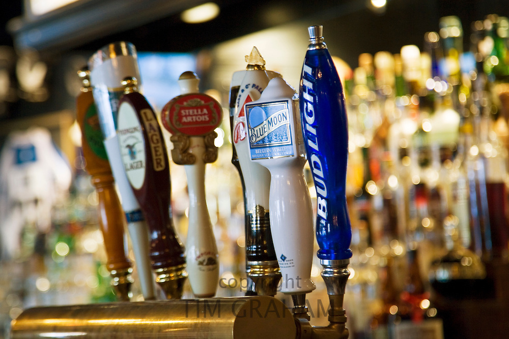 Beer taps in Georgetown bar, Washington DC, USA